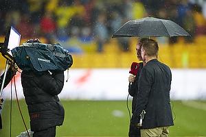 Tv-kommentatorer i regnen